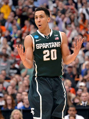 Travis Trice waves his hands as if they are on fire after a 3-point shot against Louisville.