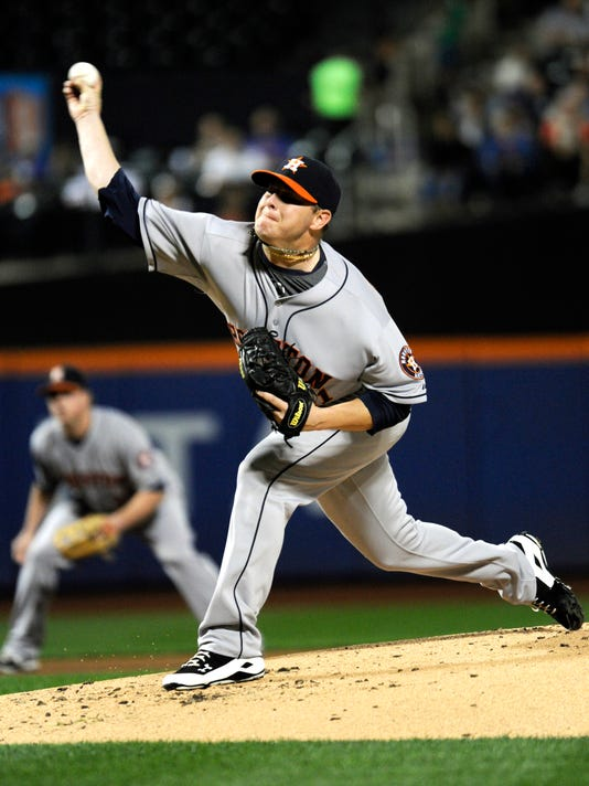 Houston Astros pitcher Brad Peacock delivers the ball to the New York Mets during the first inning of a baseball game Friday, Sept. 26, 2014, at Citi Field in New York. (AP Photo/Bill Kostroun)