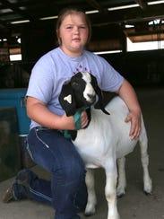 Caroline Tilton, 12, shows her goat Jack at the Richland