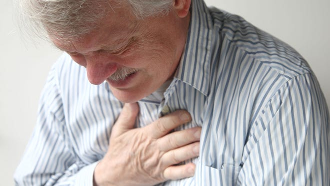 A senior man suffering from bad pain in his chest.