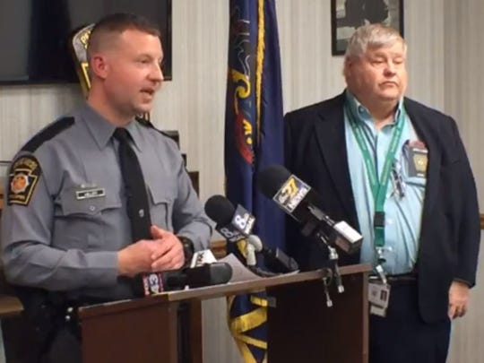 Trooper Brent Miller and county coroner Jeff Conner, at a press conference announcing charges in the death of a 3-year-old girl, on Thursday, March 22.