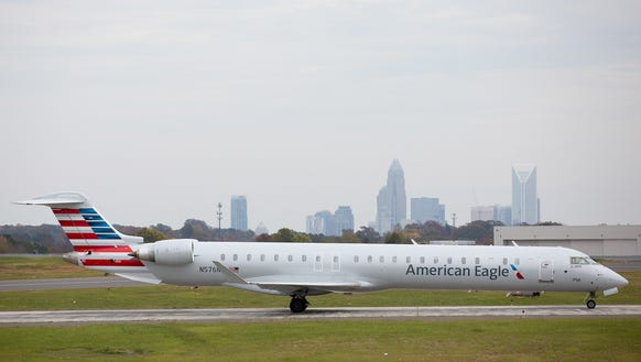 An American Eagle Bombardier CRJ-900 regional jet taxis