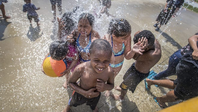 Kids keep cool by getting soaked at the Municipal Gardens splash park in Indianapolis.