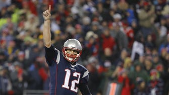 New England Patriots quarterback Tom Brady (12) celebrates after a touchdown by running back LeGarrette Blount (not pictured) against the Pittsburgh Steelers during the third quarter in the 2017 AFC Championship Game at Gillette Stadium.