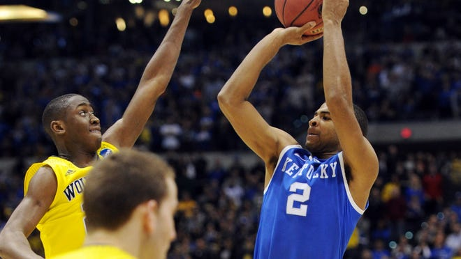 Aaron Harrison made a 3-pointer from NBA range with 2.3 seconds left Sunday to lift Kentucky by Michigan.