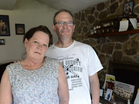 In this Tuesday, June 13, 2017 photo, Jack and Ellen Kochu, whose son Paul Kochu went missing in 2014, and was found dead in the Ohio River four months later, pose for a at their home in Bucktown, Pa. (Rebecca Droke/Pittsburgh Post-Gazette via AP)