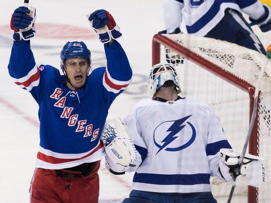 New York Rangers left wing Chris Kreider (20) and Tampa Bay Lightning goaltender Louis Domingue react after center Kevin Hayes scored a goal during the third period of an NHL hockey game Saturday, Feb. 2, 2019, at Madison Square Garden in New York. The Lightning won 3-2. (AP Photo/Mary Altaffer)