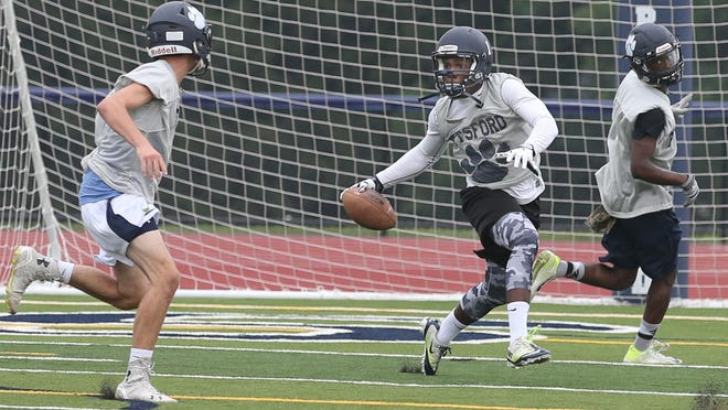 Pittsford's Josh Mack, RB, looks for room to run on a kickoff drill. Mack gained more than 2,000 all-purpose yards in a season that saw him make the Democrat and Chronicle's AGR team.