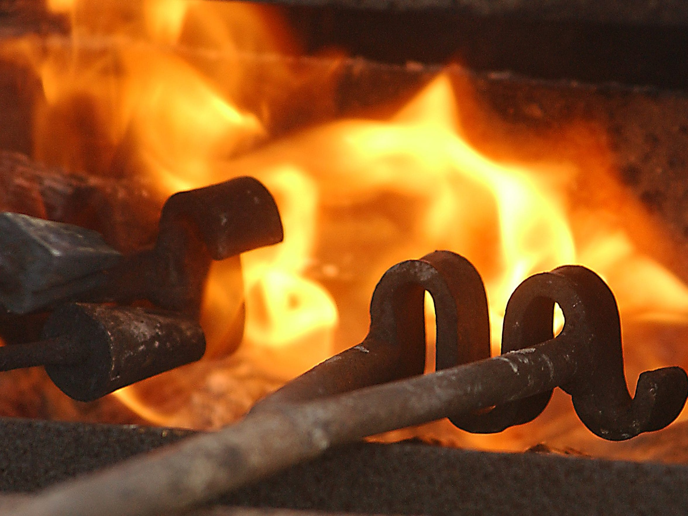Branding irons are heated in flames at King Ranch during the Ranch Hand Breakfast.