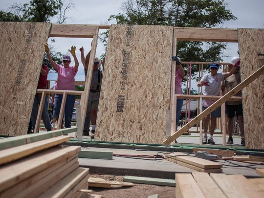 Habitat for Humanity workers and volunteers work to raise a home in St. George in this file photo. Washington City is proposing to waive impact fees for three new homes each year as long as they meet certain income guidelines as part of a larger effort to provide moreattainable housing.