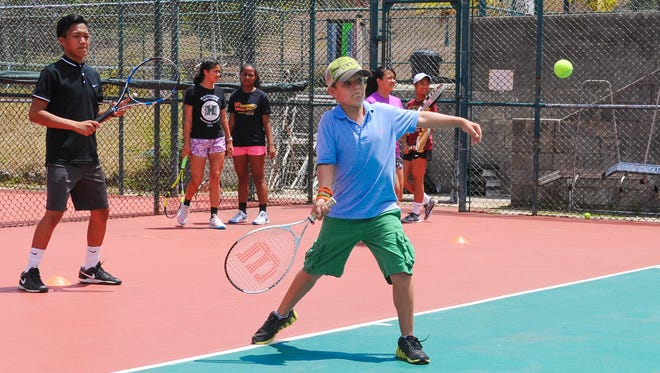 Youths participating in the Summer Tennis Camp, hosted by the Tennis Academy of Guam, practice their tennis skills at the Sheraton Laguna Guam Resort in Tamuning on Monday, June 6. The children, ranging in ages of eight-years-old and 16-years-old, enrolled in the program also enjoy swimming at the resort, said Joe Cepeda, camp director.