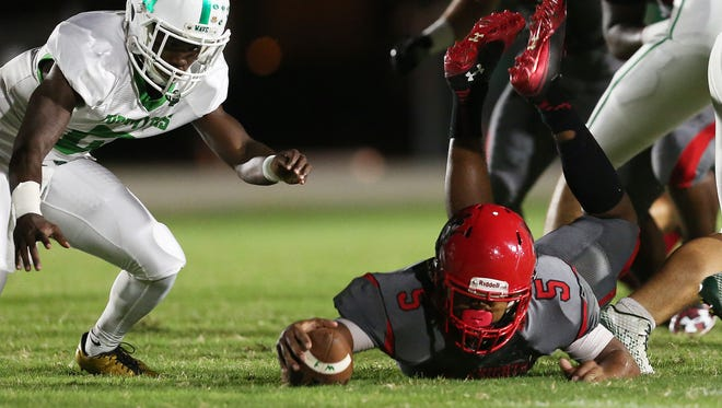 KINFAY MOROTI/THE NEWS-PRESS… North Fort Myers senior Fa'Najae Gotay recovers a Fort Myers fumble during first quarter play Friday, Sept. 1, 2017, at North Fort Myers High School.