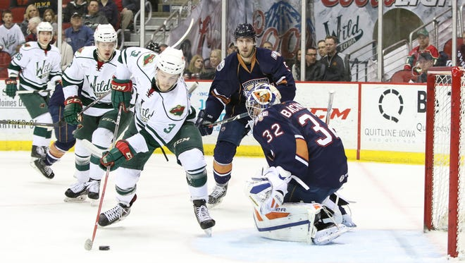 Wild rookie forward Grayson Downing attempts to slip a backhand shot past Oklahoma City goalie Richard Bachman in the second period of Friday night's game.