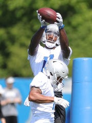 Lions receiver Andy Jones goes through drills during