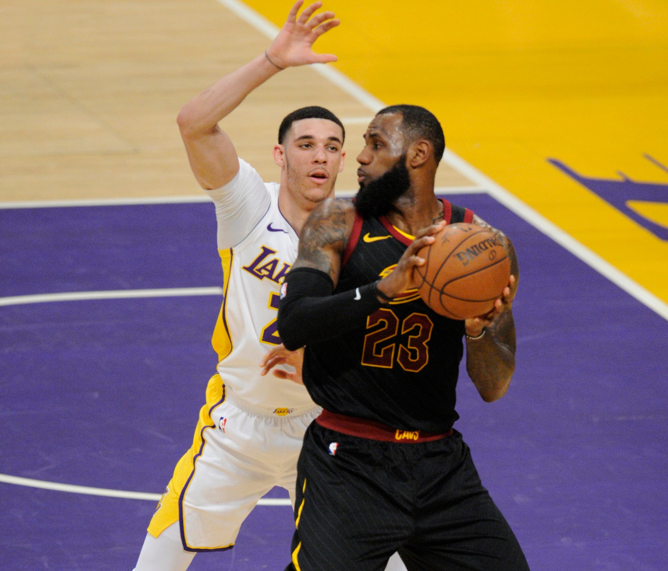 March 11, 2018; Los Angeles, CA, USA; Cleveland Cavaliers forward LeBron James (23) moves the ball against Los Angeles Lakers guard Lonzo Ball (2) during the first half at Staples Center. Mandatory Credit: Gary A. Vasquez-USA TODAY Sports