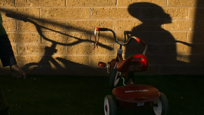The shadow a 2-year-old boy is seen at Child Crisis Arizona on January 28, 2016. The shelter houses nearly 30 children ages 0 through 8, who are primarily brought in from the Arizona Department of Child Safety. The children stay at the shelter an average of six to nine months.