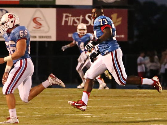 USJ's Trey Smith runs off the field after a big play in a game last season.