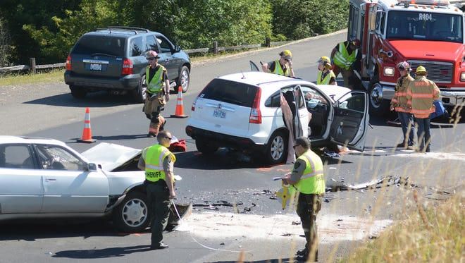 FILE — Deputies from the Marion County Sheriff's Office and the Silverton Fire District respond to a a head-on crash near the Pudding River on Silverton Road on July 30, 2014.