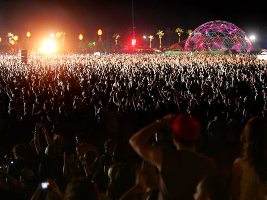 A sea of fans watches as the reunited Rage Against the Machine performs Sunday, April 30, 2007 during their headlining performance at the Coachella Valley Music and Arts Festival in Indio.