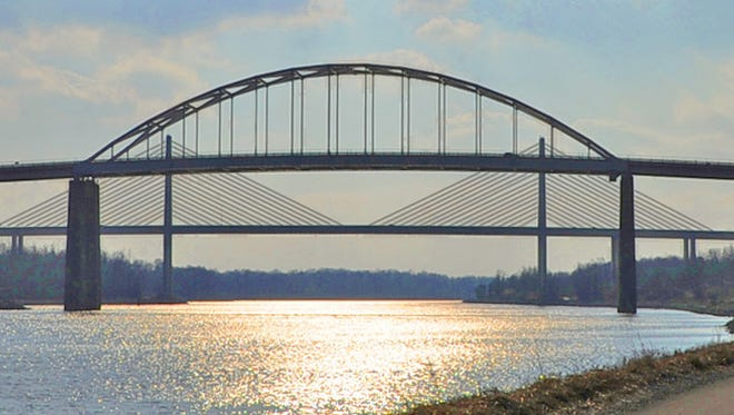The St. Georges and Roth Bridges appear to be superimposed upon each other when viewed from the road along the C & D Canal.