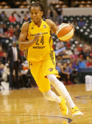 FILE --- Tamika Catchings drives to the hoop as the Indiana Fever play the Atlanta Dream at Bankers Life Fieldhouse, Friday May 20th, 2016. The Fever beat the Dream 94 to 85.