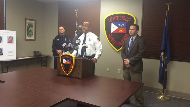 Lafayette Police Chief Reginald Thomas, accompanied by Cpl. Paul Mouton, Councilman Kenneth Boudreaux and Det. Stephen Bajat, announces arrests made in two shooting deaths