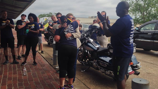 Pineville City Marshal Sarah Smith hugs Rapides Parish Sheriff Sgt. Wendy Charrier, who coordinates the Central Louisiana portion of the Law Enforcement Special Olympics Torch Run. This is the first year that the marshal's office has participated in the run.