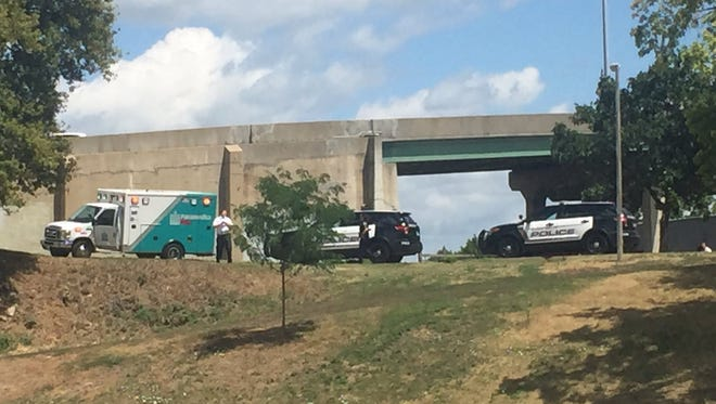 Emergency personnel and police respond to a stabbing near the 10th Street viaduct in Sioux Falls on Thursday, July 14.