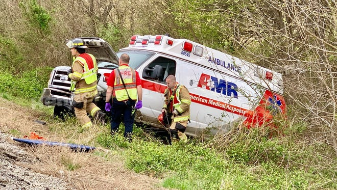 Henderson City and County first responders at the scene of an ambulance crash on I-69 (April 11, 2019).