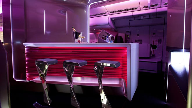 Upper-class passengers on Virgin Atlantic flights can stretch their legs at the onboard bar while sipping cocktails at 35,000 feet.