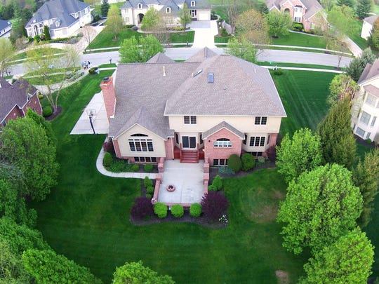 The Drone About service, which took this image of a Fishers home, is increasingly popular with agents who sell pricier homes, its co-founders say.