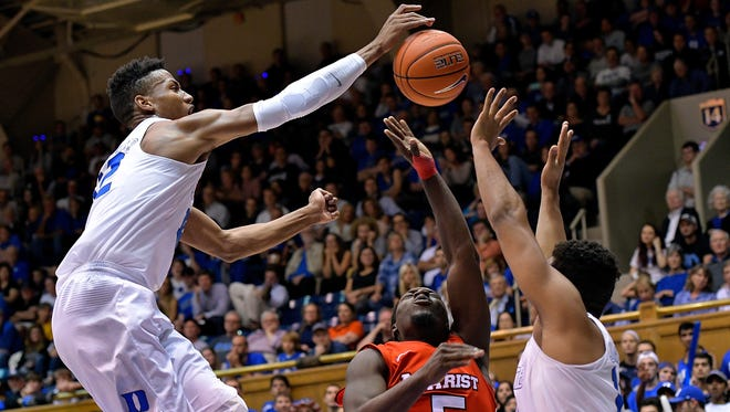 Javin DeLaurier #12 of the Duke Blue Devils blocks a shot by Khallid Hart #5 of the Marist Red Foxes during the game at Cameron Indoor Stadium on November 11, 2016 in Durham, North Carolina. Duke won 94-49.