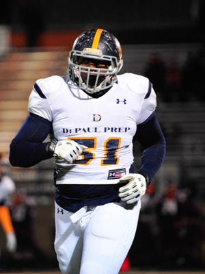 Highly recruited Defensive End Raequan Williams of DePaul Prep leaves the field against Brother Rice for the Catholic League Playoffs at Brother Rice, Thursday, November 13th, 2014, in Chicago.
