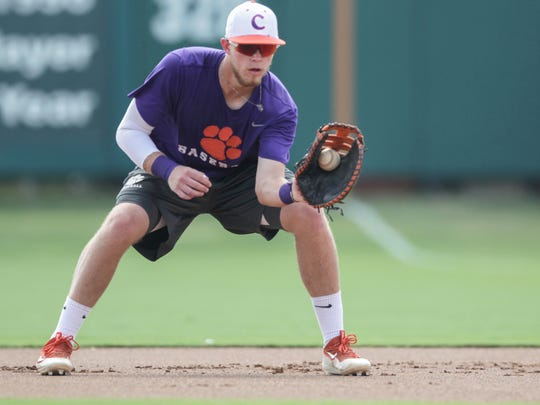 Clemson's Seth Beer (28) fields a ball at first base during the first fall practice September 16 at Doug Kingsmore Stadium in Clemson.