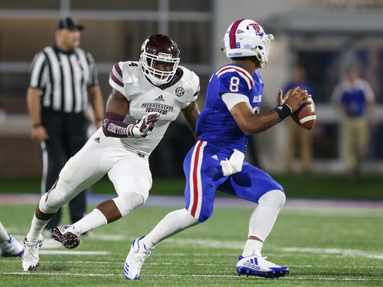 Mississippi State's Gerri Green (4) applies pressure to Louisiana Tech's J'Mar Smith (8) in last year's Mississippi State vs. Louisiana Tech game. Photo by Keith Warren (Mandatory Credit)