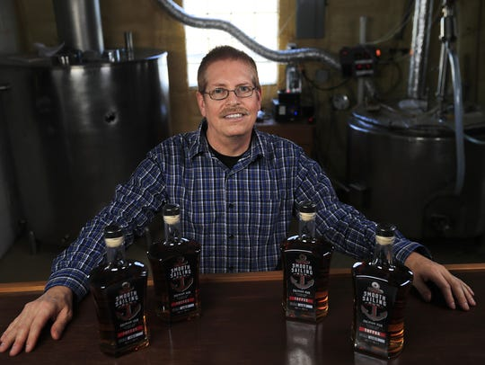 Curt Naegeli, owner of North Woods Distillery, sits