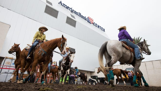Barrel racers warm up her horse behind the American Bank Center before competing in the slack competition at the Rodeo Corpus Christi, Wednesday, April 13, 2016.