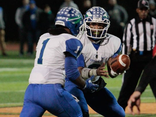 Winton Woods quarterback Kenny Mayberry hands the ball