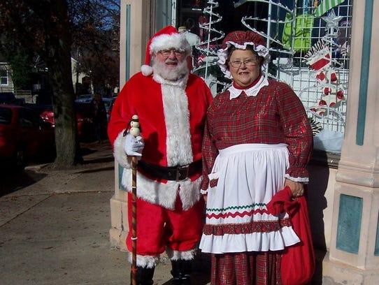 Ed and Janet Ulsas, dressed as Santa and Mrs. Claus,