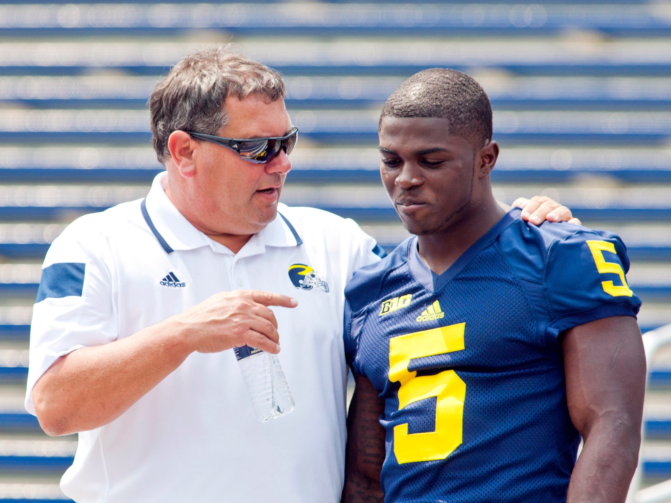 Brady Hoke, left, speaks with Jabrill Peppers on Aug.