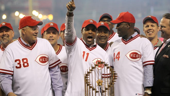 (From left:) Former Reds Keith Brown, Barry Larkin and Eric Davis celebrate around the 1990 World Series Championship trophy during a postgame celebration on April 24, 2015.