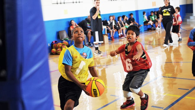 Javance Coleman, Jr., 8, drives toward the hoop during the City of Salinas Summer Basketball Clinic at the Recreation Center. The two 5-day clinics for youth began on Monday, June 13th.