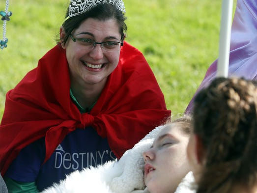 Cassie Jastrzembski, left, chats with Destiny Mann, 10, of Portland, and her grandmother Bobby Joe Sumpter, right, at the Make-A-Wish Oregon's Walk for Wishes 5K at Salem's Riverfront Park Saturday, April 26, 2014. Destiny's wish was to meet Cassie, who was paired up to run for her through I Run 4, which pairs runners with people who canÕt physically run.