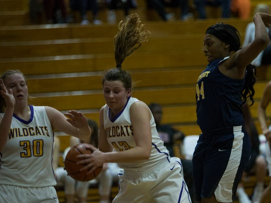 Lucy Chilcutt, 13, tries to avoid a block from Nevaeh Tharpe, 44, during Clarksville High's game against Northeast on February 6, 2018.