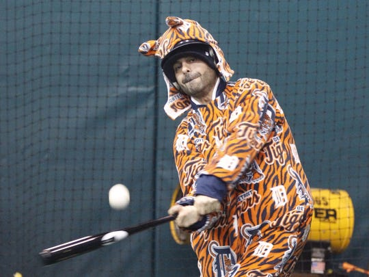 Detroit Tigers fan Hussein Saad of Dearborn hits in the visitor's batting cages during TigerFest at Comerica Park on January 25, 2014.