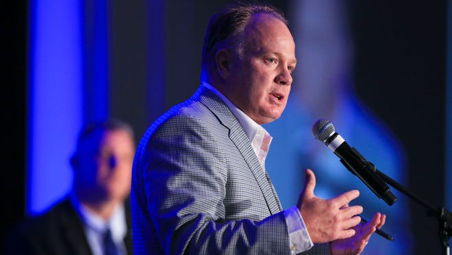 """Coach Mark Stoops speaks at the Greater Louisville  UK Alumni Association at the Galt House Friday afternoon. """"It's always fun to come (to Louisville). Particularly this year,"""" he said, drawing cheers and laughs."""