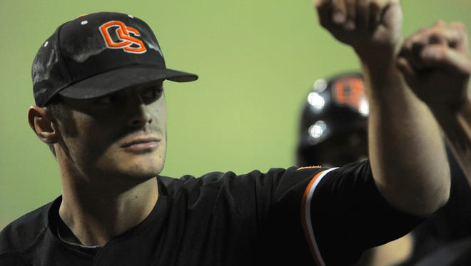 Oregon State's Ben Wetzler is congratulated at the end of the seventh inning of an NCAA college super regional tournament baseball game against Kansas State in Corvallis, Ore., Monday June 10, 2013.  (AP Photo/Greg Wahl-Stephens)