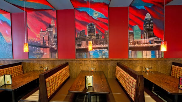Take a look inside Mellow Mushroom's new pizzeria location in Oakley's Hyde Park Plaza. Booths along the wall are decorated with hand-painted murals of Cincinnati's skyline.