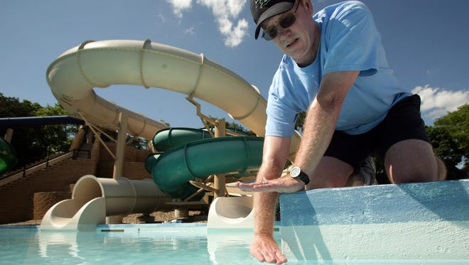 The opening at West Des Moines Holiday Park Aquatic Center was delayed in 2007 because the pool was leaking an estimated 40,000 gallons of water a day. It's an ove flow-type pool, so the water level should be right at the lip of the pool, as demonstrated in 2007 by Mark Brewick, recreation supervisor.