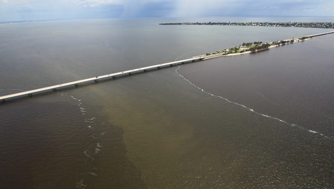 The demarcation line between the waters of the Caloosahatchee River and the Gulf of Mexico near Sanibel Island is apparent in these Aug. 20, 2013 photos due to Lake Okeechobee water releases and summer rain runoff.